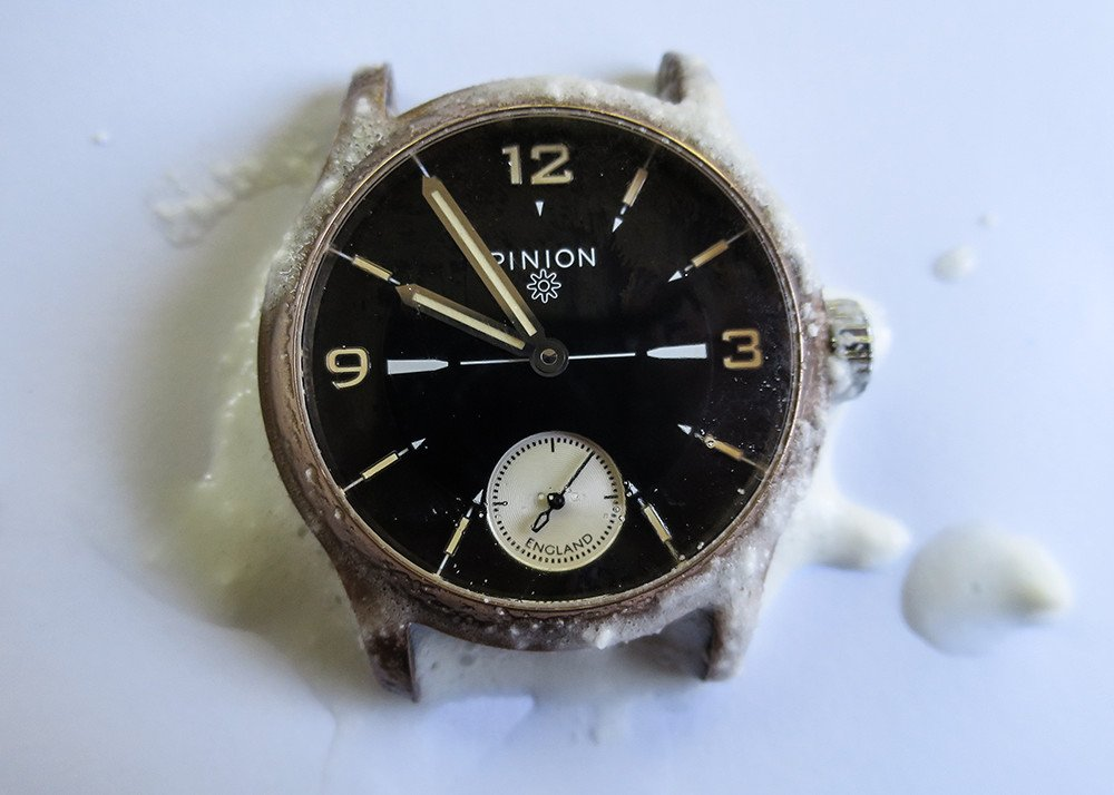 cleaning a bronze watch with baking soda